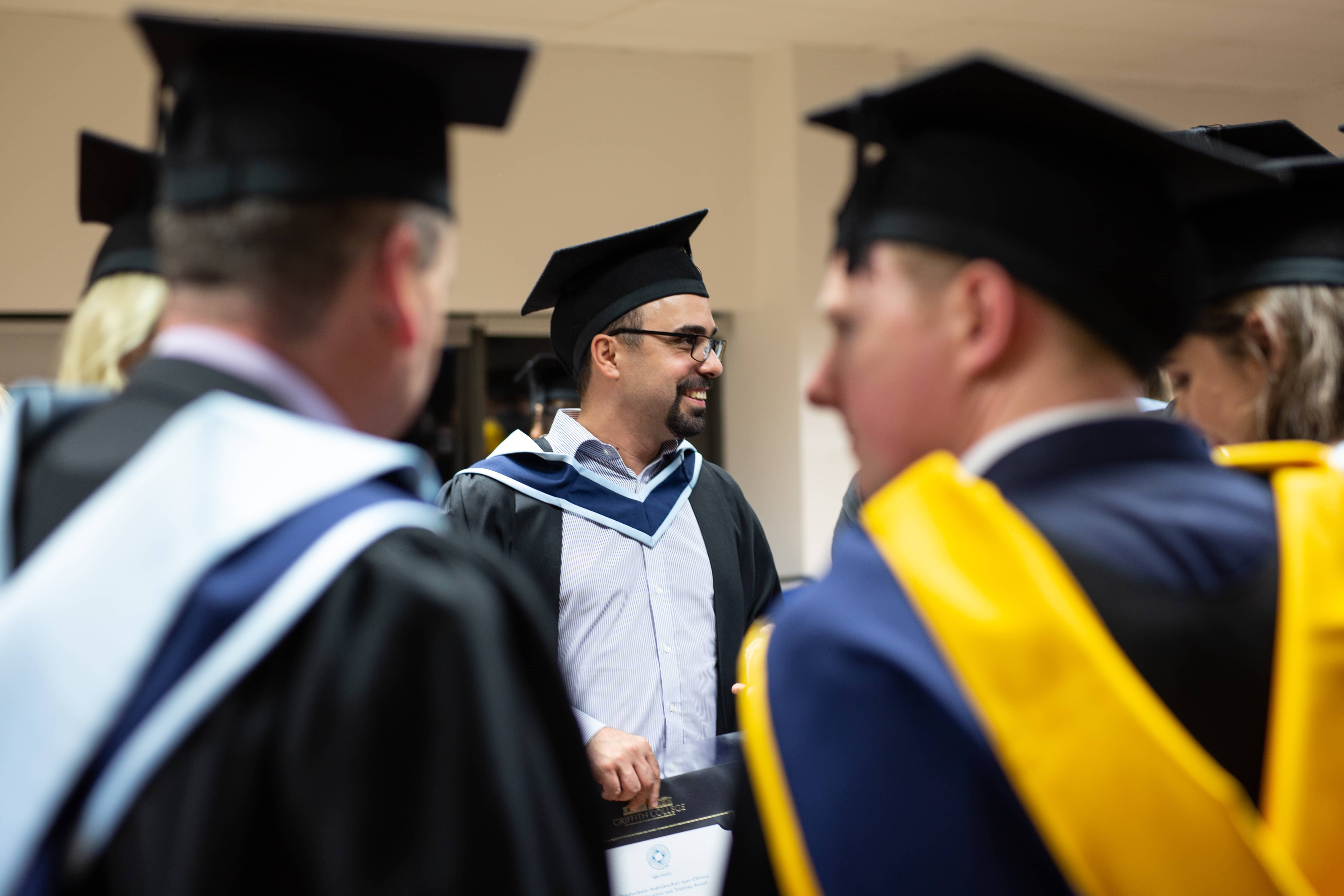 A group of Innopharma Education students talking on graduation day